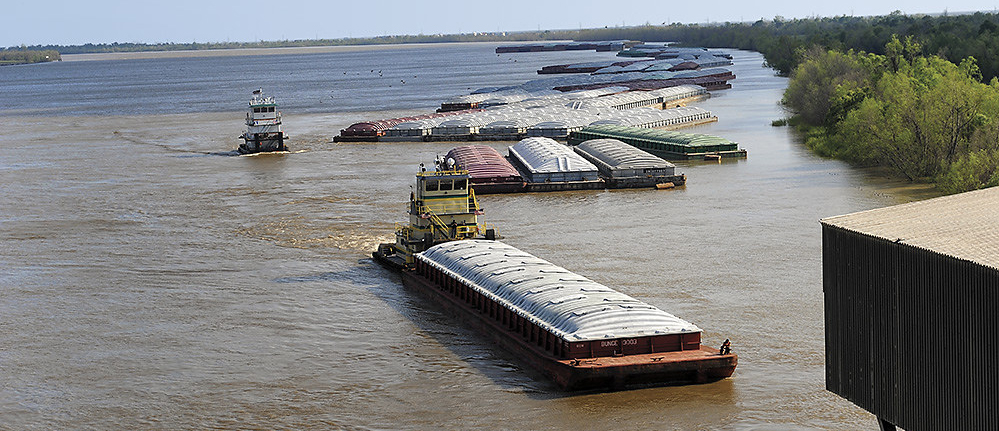 Barges moving down the river