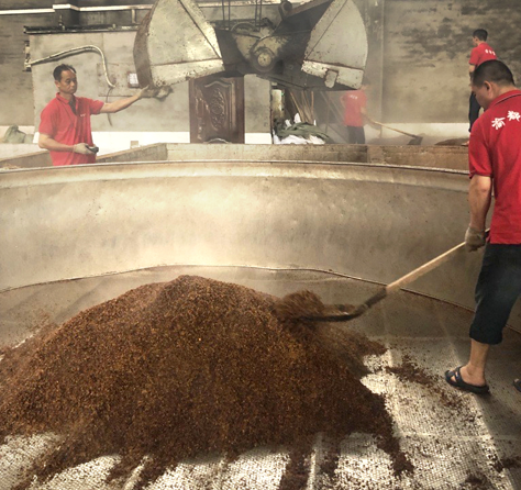Workers using sorghum to make Baiju, a Chinese spirit.