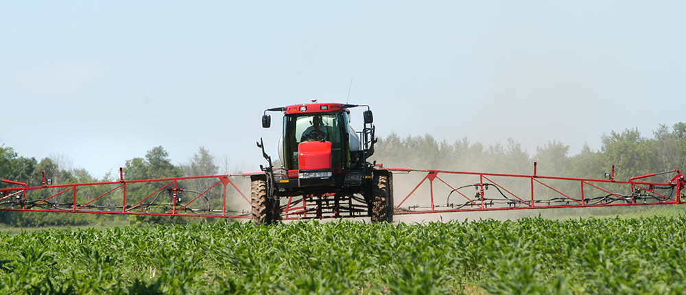 Farm equipment spraying herbicide