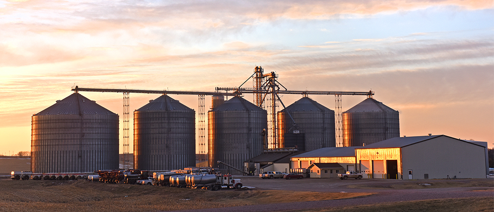 Image of a grain elevator in sunset.