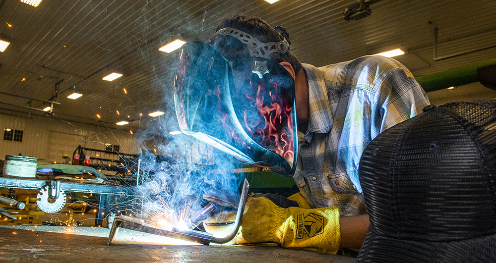 Person welding with protective gear