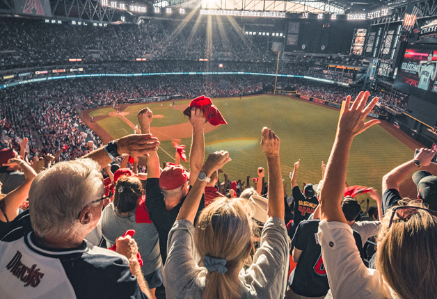 People cheering at a baseball stadium